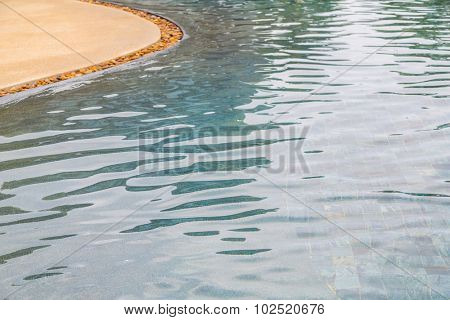 Swimming pool rippled water