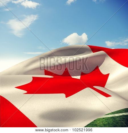 Low angle view of Canadian flag against sky with clouds