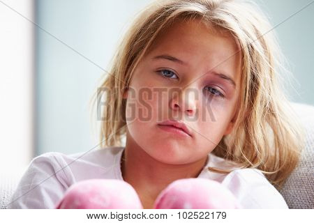Portrait Of Physically Abused Child At Home