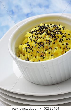 Rice (Boiled With Curcuma) And Black Sesame Topping