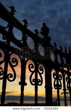Fence In Sunset