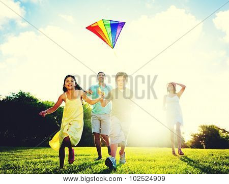 Family Flying Kite Outdoors Concept