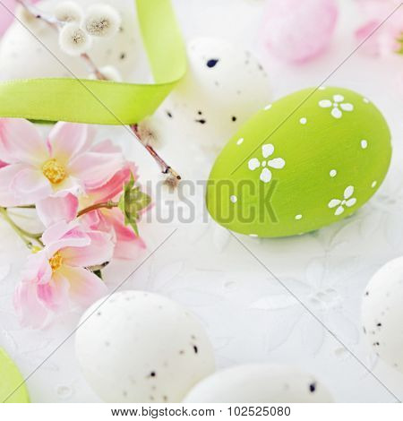 colorful easter eggs and spring flowers