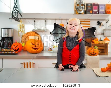 Happy Halloween Dressed Girl In Decorated Kitchen