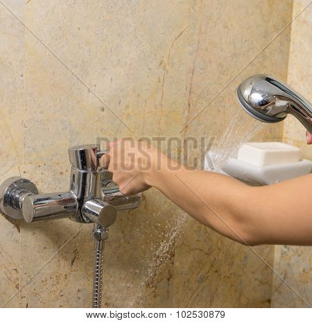 Hand Holds A Shower And Open On Marble Background