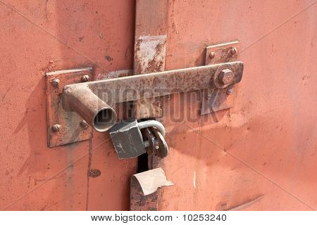 Detail Of Closed Rusty Door With Padlock