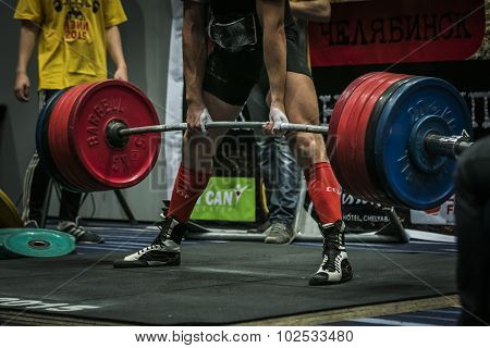 athlete performs a deadlift