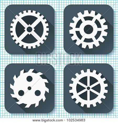Set of four flat gear icons with long shadows on a millimeter engineering paper background.