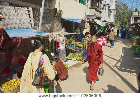People walk by the street in Bandarban, Bangladesh.