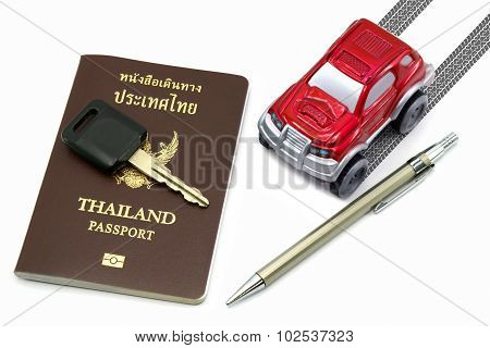 Thailand Passport, Key, Pen And Red 4Wd Car For Travel Concept