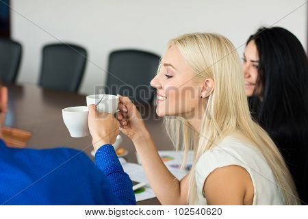 Business Blonde Woman With A Cup Of Coffee With The Boss In The Office