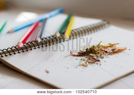 colored pencils and shavings from them