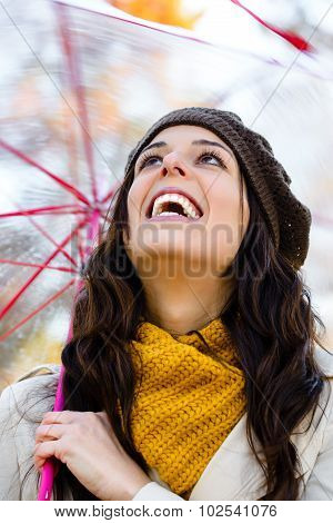 Playful Woman Enjoying Autumn
