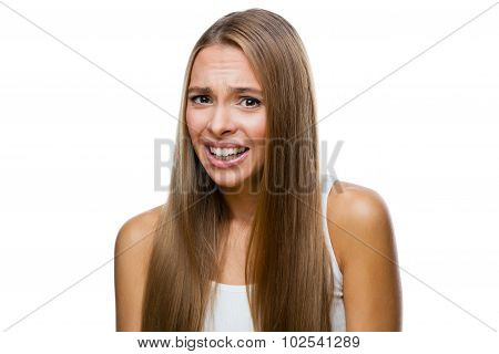 Portrait of frowned woman on white background