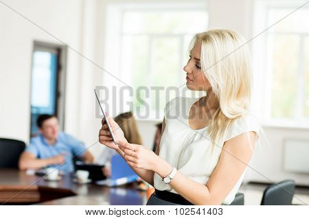 Portrait Of A Young Business Woman With A Tablet Computer At The Office At A Business Meeting