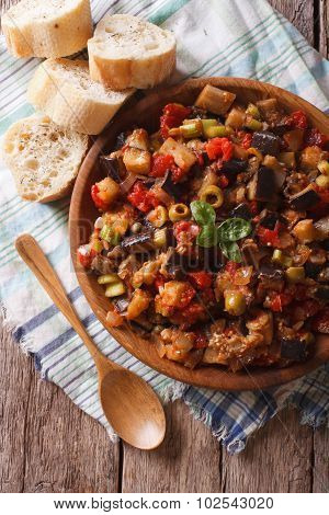 Italian Caponata With Aubergines Close-up In A Plate. Vertical Top View