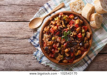 Caponata With Aubergines In A Wooden Plate. Horizontal Top View