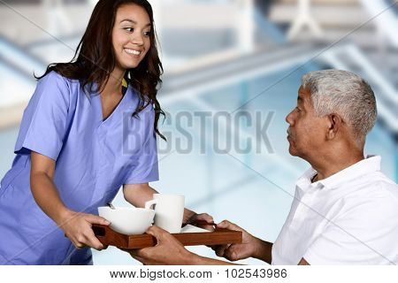 Home health care worker and an elderly man