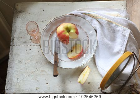 Red Apple On A Plate And Vodka In A Transparent Wine-glass