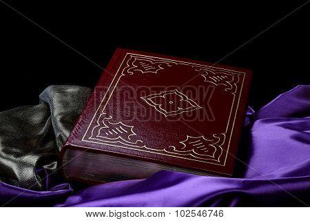 Deep Maroon Vintage Book On Purple Satin On Black