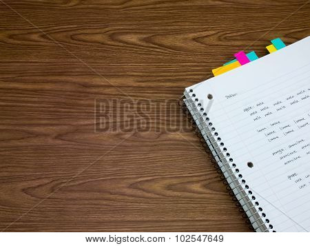Italian; Learning New Language Writing Words On The Notebook