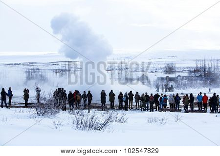 Visitors At The Geyser Erruption Of Strokkur, Iceland