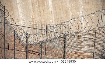 Barbed Wire Fence, Crime And Punishment Concept Photo.