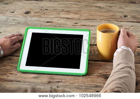 White Tablet Computer  With A Cup Of Coffee