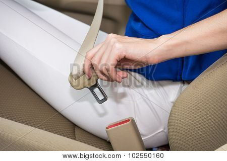 Woman Hand Fastening A Seat Belt In The Car 1