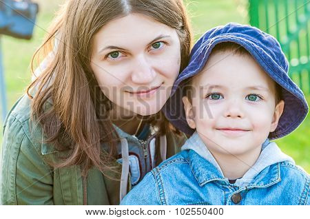 Portrait Of Young Woman And Her Boy