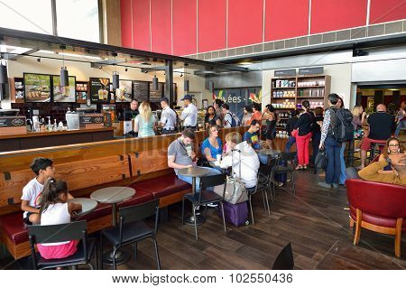 PARIS - AUGUST 08, 2015: Starbucks cafe in Orly Airport. Paris Orly Airport is an international airport located partially in Orly and partially in Villeneuve-le-Roi, 7 NM south of Paris, France