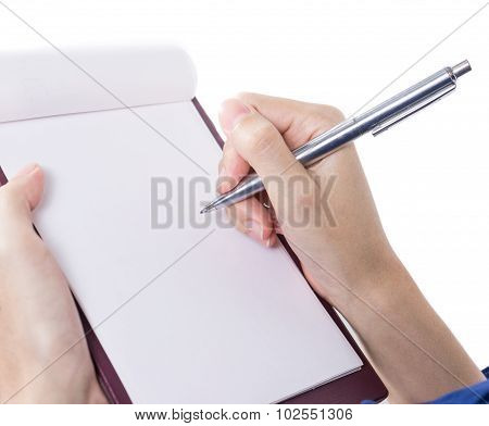 Close-up Of Female Hand Holding A Pen And Writing 1