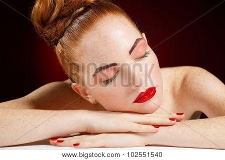 Studio portrait of sleeping woman