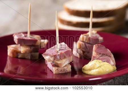Pieces Of Aspic With Mustard