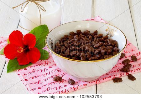 Cereal Chocolate Balls Jug Of Milk On A White Wooden Table