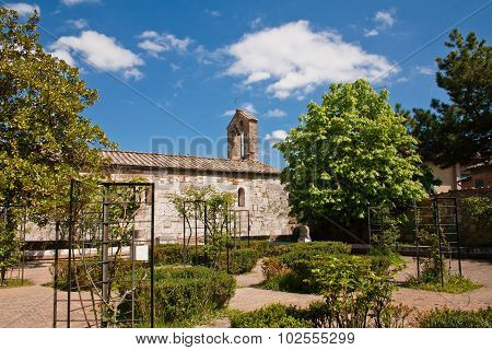 Old Roman Church In Garden
