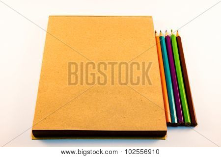 Brown Paper Notebook With Pencils