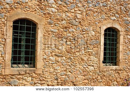 The Wall Of An Old House With Two Windows.