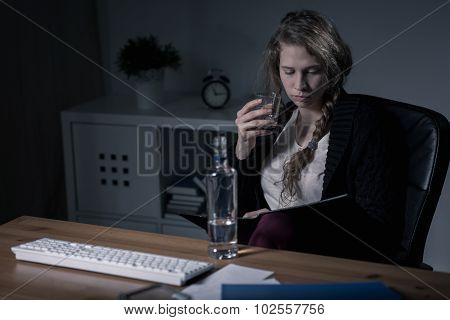 Woman Drinking At Work