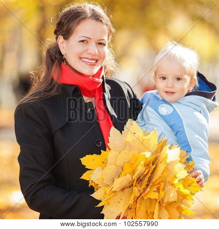Mother with son in the autumn park