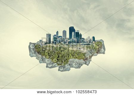 City construction model with cogwheel mechanism on sky background