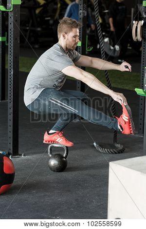 Balancing Squat On The Kettlebar
