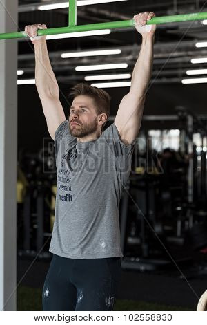 Sporty Man Doing Pull Ups