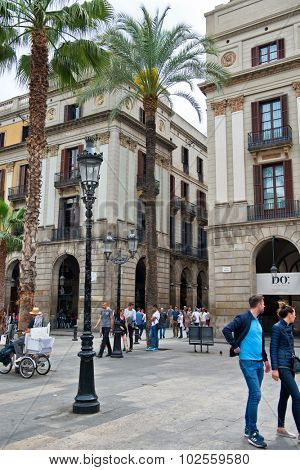 BARCELONA, SPAIN - MAY 02: Bustling Urban Pedestrian Street Scene at Placa Reial in Barcelona, Spain, May 02, 2015
