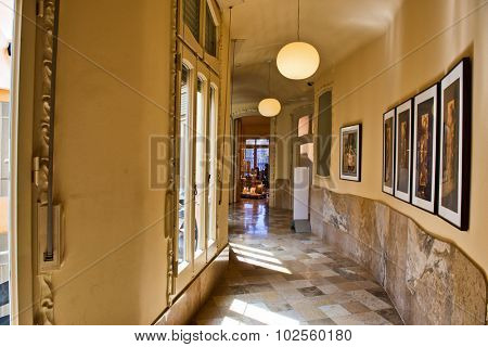 BARCELONA, SPAIN - MAY 02: Framed Artwork Lining Brightly Lit Hallway Inside Casa Mila, Barcelona, Spain, May 02, 2015