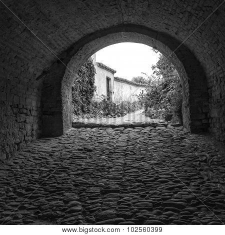 Monforte d'Alba (Cuneo); old alley. Black and white photo