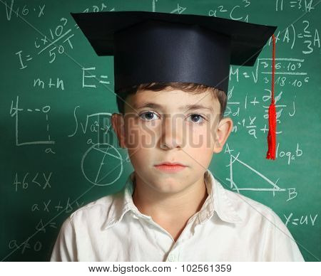 Boy In Graduation Cap   Blackboard Background