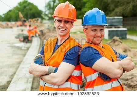 Young Builders In Helmets