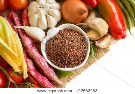 Red Rice In Bowl And Fresh Vegetables