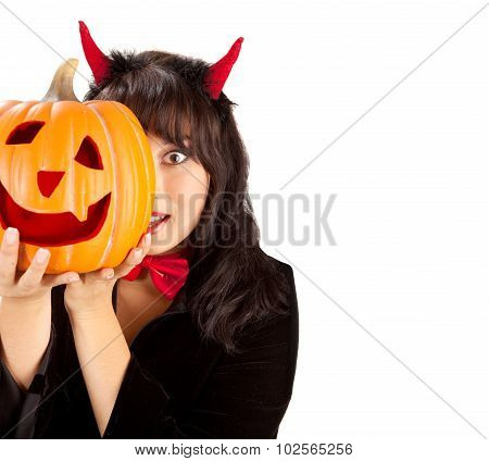Woman Holding  Pumpkin In A Costume Of Black Devil On A White Background